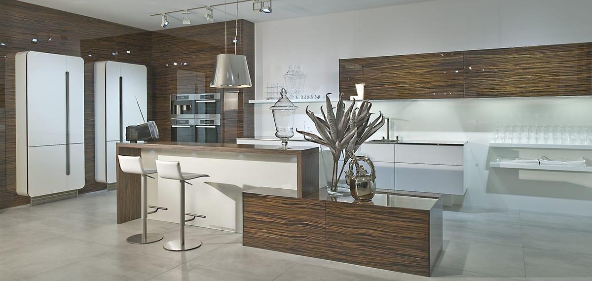 Macassar Ebony gloss veneer kitchen with white design glass 1200 | Qudaus Living, Sutton Coldfield
